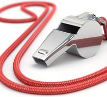 A whistle with red string.