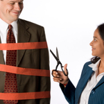 Woman cutting red tape from man