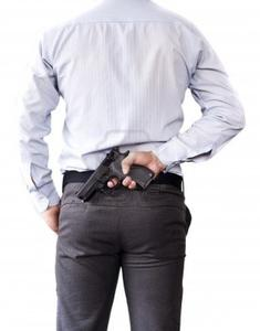 13829429-businessman-and-gun-in-hand