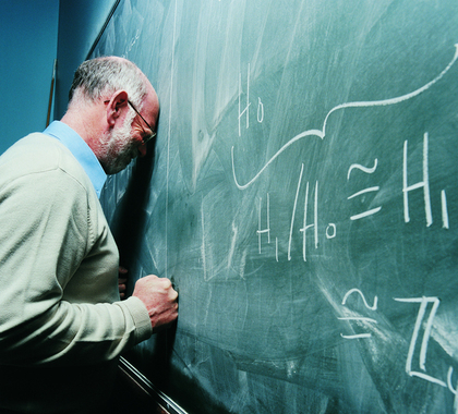 Frustrated science teacher at blackboard