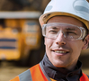 Smiling coal miner wearing safety goggles