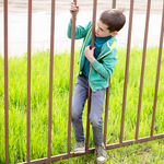 Boy trying to get through fence