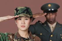 Young female Marine and older mail Marine saluting.