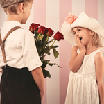 Boy child giving flowers to girl child