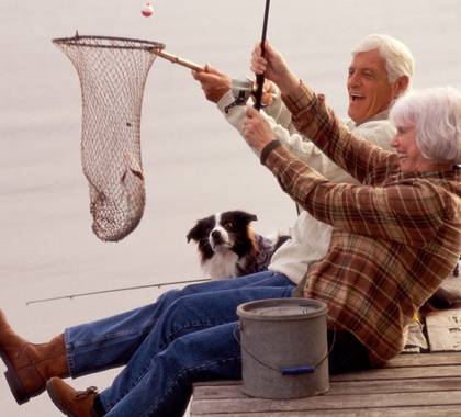Senior citizen couple fishing