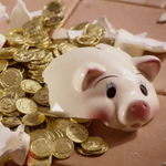 Smashed piggy bank and coins