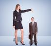 Tall woman pointing down at small man